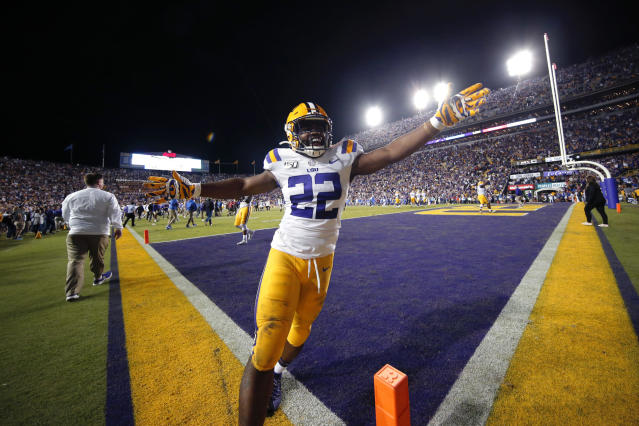 LSU running back Clyde Edwards-Helaire (22) celebrates after the team defeated Florida 42-28 in an NCAA college football game in Baton Rouge, La., Saturday, Oct. 12, 2019. (AP Photo/Gerald Herbert)