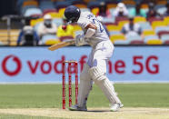 India's Cheteshwar Pujara reacts as he is hit while batting during play on the final day of the fourth cricket test between India and Australia at the Gabba, Brisbane, Australia, Tuesday, Jan. 19, 2021. (AP Photo/Tertius Pickard)
