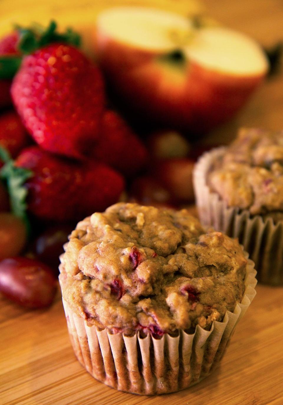 "<p>Skip the added sugars and bake these fruit-sweetened muffins. And don't worry if your strawberries are a little shriveled or your grapes a little soft - just like the bananas, they bake up beautifully so they won't have to go to waste. </p> <p><strong>Calories:</strong> 100 per muffin<br> <strong>Protein:</strong> 1.5 grams</p> <p><strong>Get the recipe:</strong> <a href=""https://www.popsugar.com/fitness/Banana-Muffin-Recipe-33241326"" class=""link rapid-noclick-resp"" rel=""nofollow noopener"" target=""_blank"" data-ylk=""slk:banana strawberry apple grape muffins"">banana strawberry apple grape muffins</a></p>"