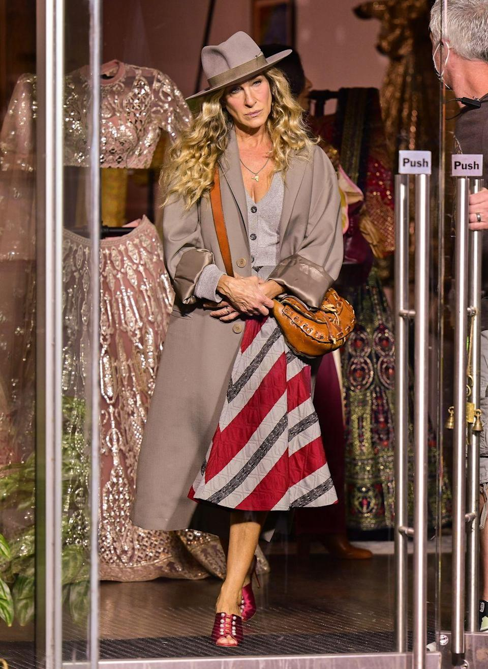 <p>The actor returned to the set of And Just Like That on September 27, days after her SATC co-star Willie Garson passed away, aged 57. The actress looked somber dressed in a grey coat, striped skirt and wide-brimmed hat in SoHo. </p>