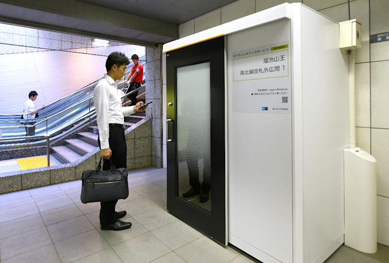Some stations on Tokyo's metro now boast office cubicles equipped with desk, chair, computer display and wifi (AFP Photo/Kazuhiro NOGI)