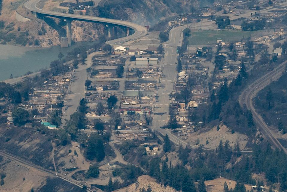In this aerial photo taken from a helicopter, structures destroyed by a wildfire are seen in Lytton (AP)