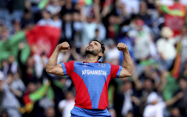Afghanistan's captain Gulbadin Naib celebrates the dismissal of England's Jonny Bairstow during the Cricket World Cup match between England and Afghanistan at Old Trafford in Manchester, England, Tuesday, June 18, 2019. (AP Photo/Rui Vieira)