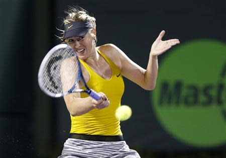 Maria Sharapova hits a forehand against Lucie Safarova (not pictured) on day six of the Sony Open at Crandon Tennis Center. Mandatory Credit: Geoff Burke-USA TODAY Sports