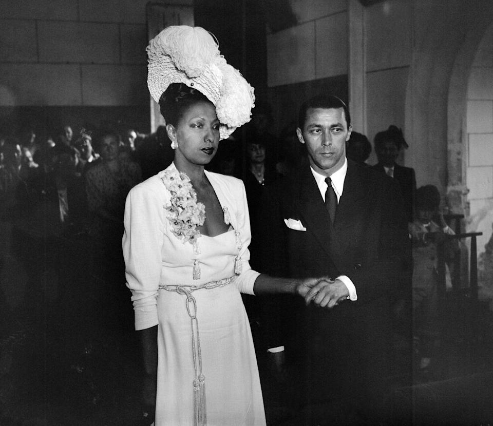 """<p>The American-born French entertainer said """"I do"""" to composer Jo Bouillon in a small ceremony in the chapel of her French chateau, Les Milandes. It was Baker's fourth marriage and the couple was together until 1961, during which time they adopted 12 children together, known as """"the rainbow tribe.""""</p>"""