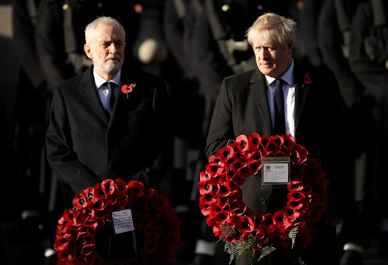 FILE - In this Sunday, Nov. 10, 2019 file photo British Prime Minister Boris Johnson, right, and leader of the Labour Party Jeremy Corbyn prepare to lay wreaths during the Remembrance Sunday ceremony at the Cenotaph in Whitehall in London. (AP Photo/Matt Dunham)