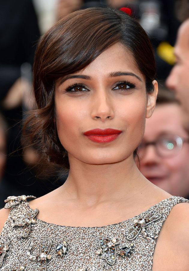 Celebrities wearing red lipstick: Freida Pinto worked the red lipstick trend in Cannes. <br><br>[Rex]