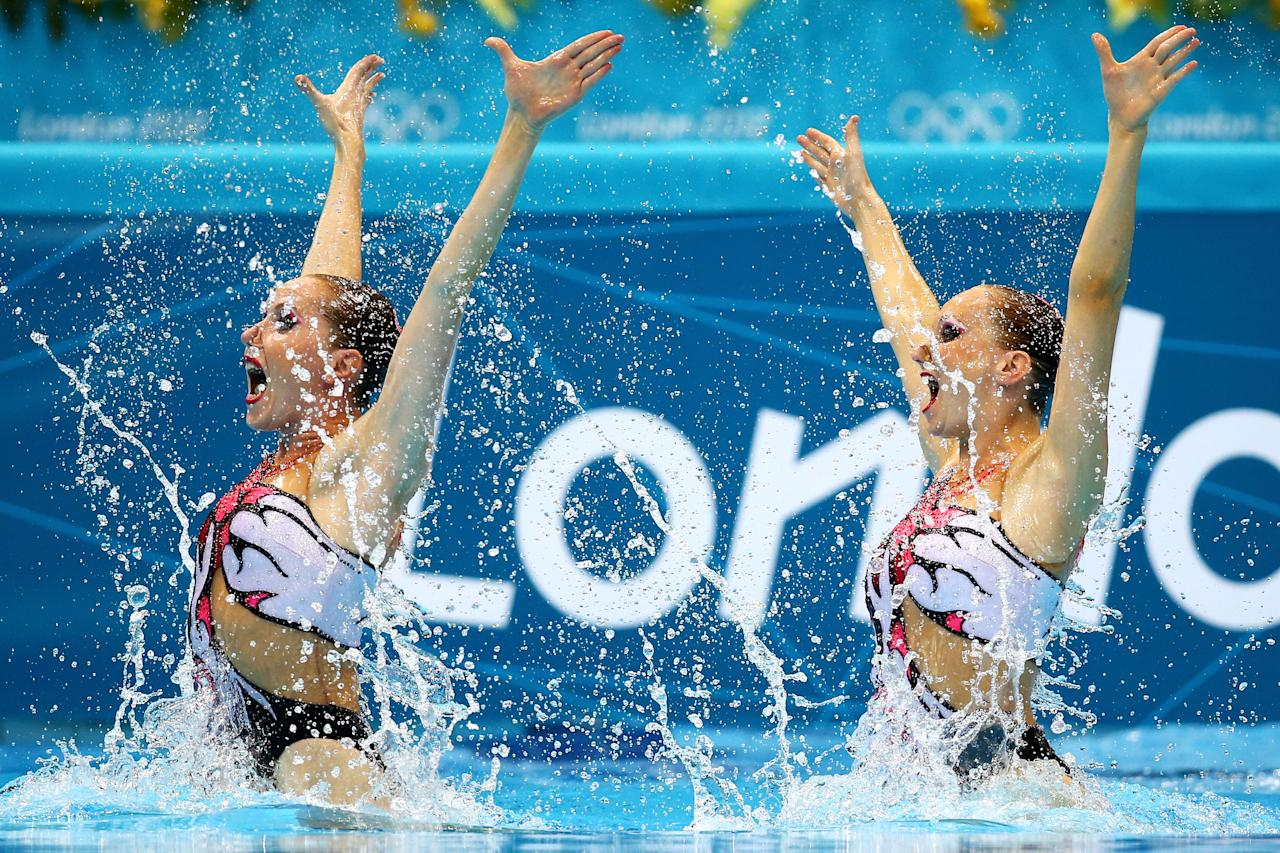 Anastasia Gloushkov and Inna Yoffe of Israel compete in the Women's Duets Synchronised Swimming Technical Routine on Day 9 of the London 2012 Olympic Games at the Aquatics Centre  on August 5, 2012 in London, England.  (Photo by Al Bello/Getty Images)