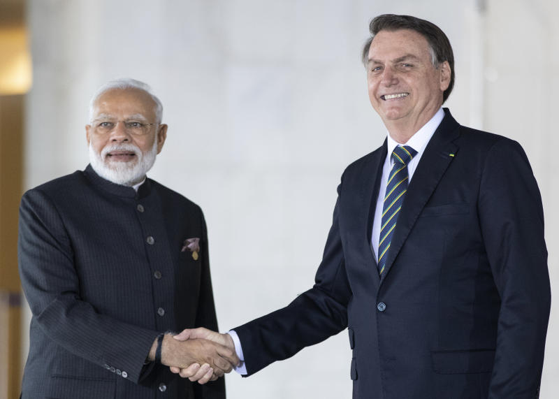 Brazil's President Jair Bolsonaro, right, and India's Prime Minister Narendra Modi pose for a photo prior to a meeting of leaders of the BRICS emerging economies at the Itamaraty palace in Brasilia, Brazil, Thursday, Nov. 14, 2019. (AP Photo/Pavel Golovkin, Pool)