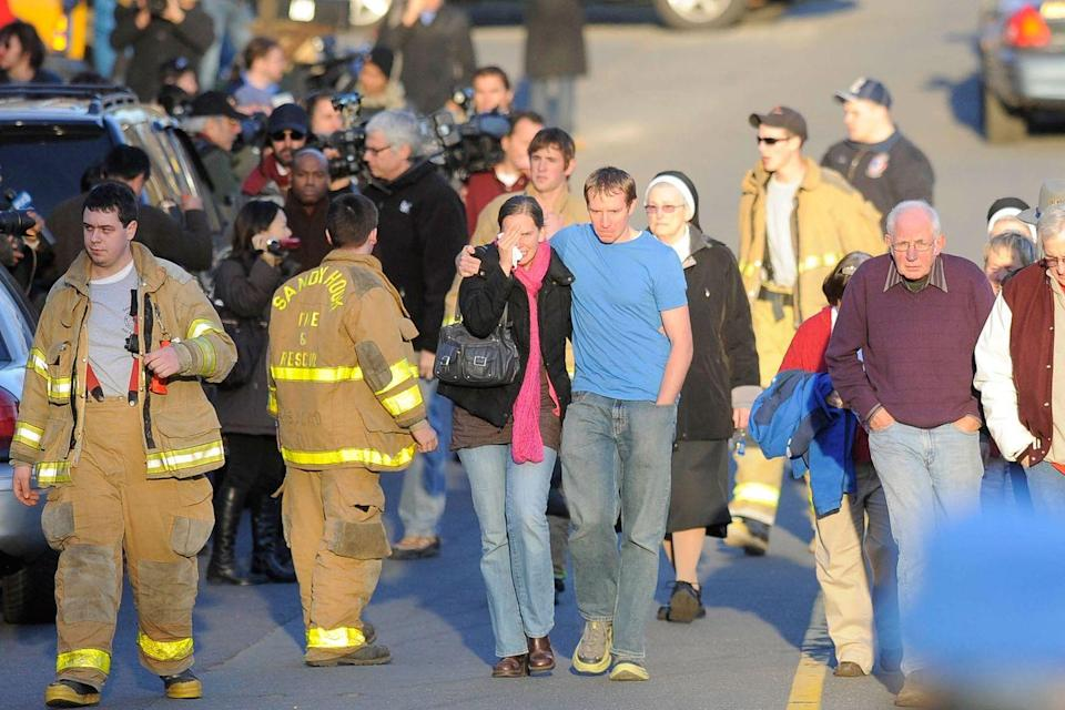 <p>Robbie and Alyssa Parker stand outside a firehouse near Sandy Hook Elementary School in Newtown, Connecticut. The Parkers' daughter, Emilie, was one of the 20 children killed in the shooting. </p>