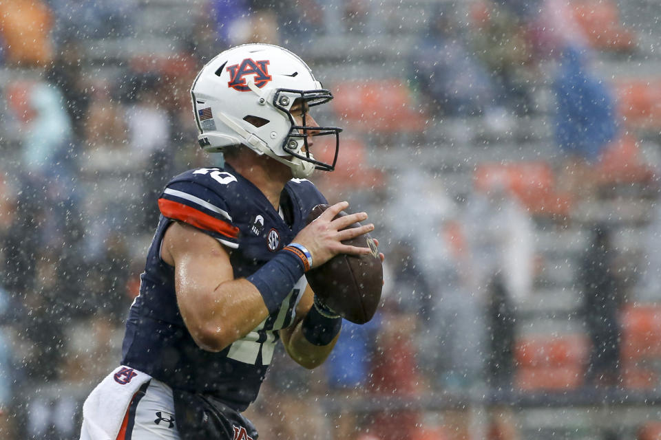 Auburn quarterback Bo Nix (10) warms up in before an NCAA college football game against Arkansas as the remnants of Hurricane Delta pass through on Saturday, Oct. 10, 2020, in Auburn, Ala.. (AP Photo/Butch Dill)