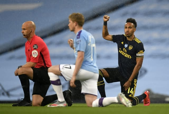 Arsenal's Pierre-Emerick Aubameyang, right, and Manchester City's Kevin De Bruyne, take the knee after the kick-off of their Premier League match on Wednesday (Peter Powell/PA)