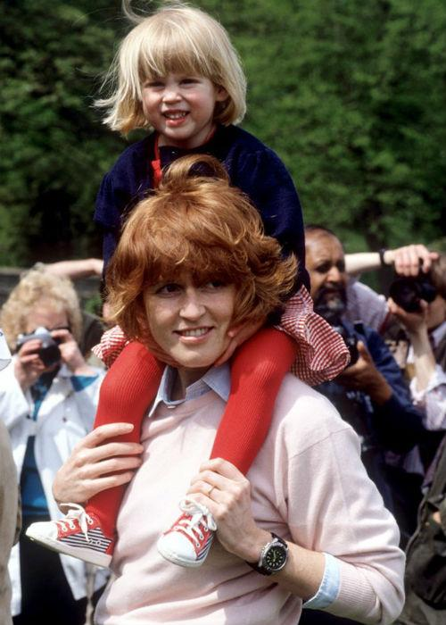 Prince Andrew's wife Sarah Ferguson was a controversial choice for the Prince—rumors were the Queen disapproved of Fergie's outspokenness and loud personality. Prince Andrew and Fergie divorced in 1992. Here is the Duchess of York with daughter Princess Beatrice at the Royal Windsor Horse Show in 1991