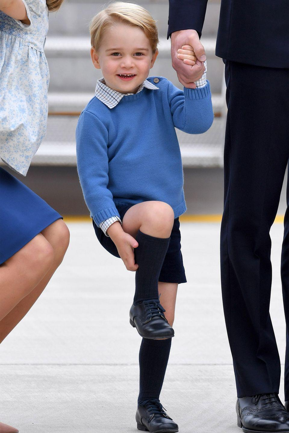 <p>Prince George adjusts his socks as he arrives at Victoria Airport ahead of the Royal Tour of Canada.</p>