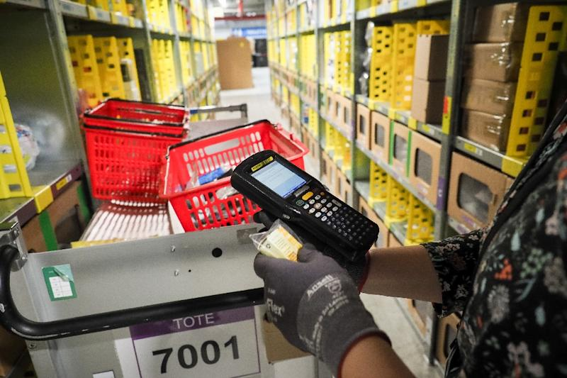 Competition from online juggernaut Amazon is forcing traditional retailers to adapt new technolgies to compete (AFP Photo/GUILLAUME SOUVANT)