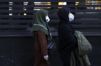 People walk as they wear masks in downtown Tehran, Iran, Thursday, Feb. 27, 2020. Amid fear and uncertainty caused by the spread of a new virus, Iranians are taking extra caution to avoid getting infected, as authorities canceled Friday prayers in Tehran, Qom and other cities. (AP Photo/Vahid Salemi)