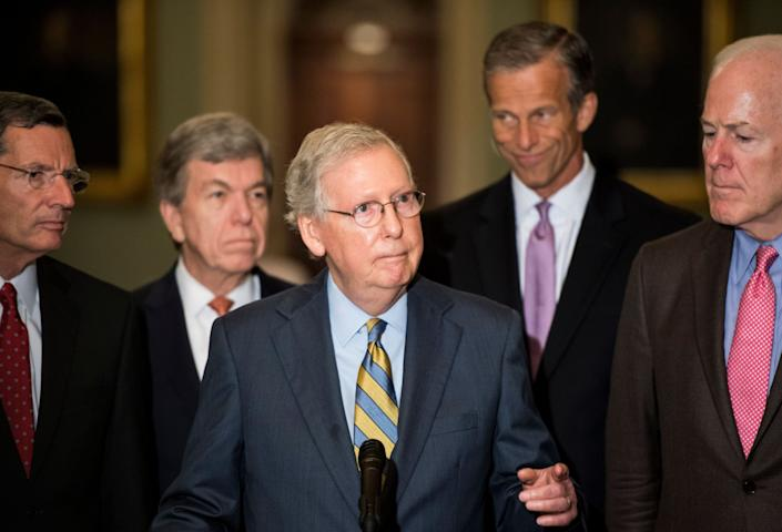 "Senate Majority Leader Mitch McConnell, center, called the latest accusation against Supreme Court nominee Brett Kavanaugh ""another orchestrated, last-minute hit on the nominee."" (Photo: Bill Clark/CQ Roll Call via Getty Images)"