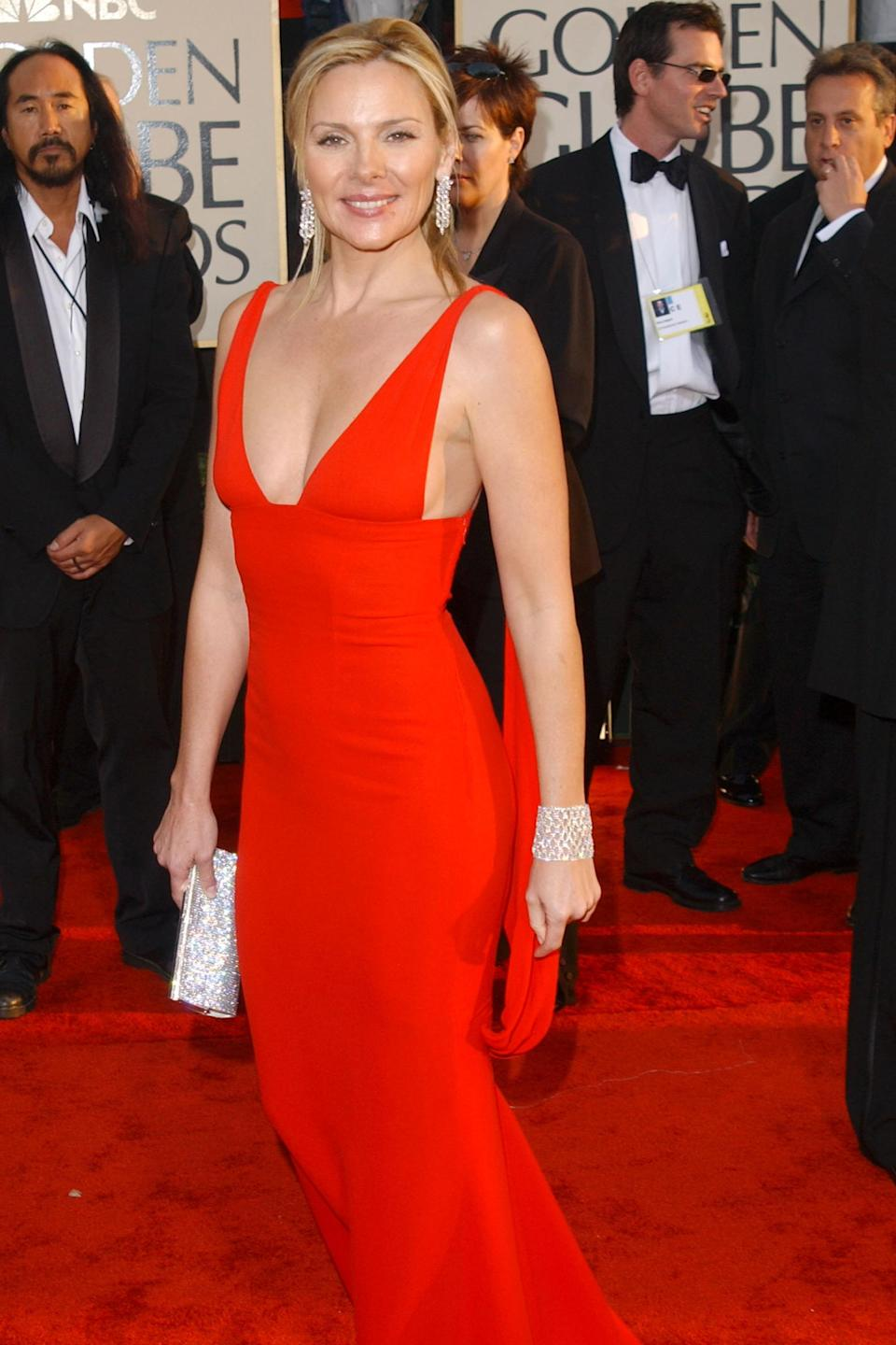 """<strong><h2>2003</h2></strong><br>Fact: Kim Cattrall can make <em>anything</em> look sexy — and this red hot Valentino number is no exception.<br><br><em>Kim Cattrall in Valentino. </em><span class=""""copyright"""">Photo: Jon Kopaloff/Getty Images.</span>"""