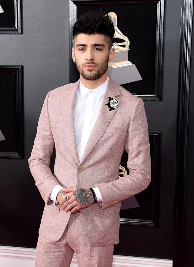 "<p>Zayn held it down for the fellas in the grooming department at the Grammys. However, Joanna Simkin was the woman behind this well-groomed look. Her product of choice: <a href=""https://www.baxterofcalifornia.com/clay-pomade/PPDBOC838364004019.html?cgid=hair-care-pomades#start=1&cgid=hair-care-pomades"" rel=""nofollow noopener"" target=""_blank"" data-ylk=""slk:Baxter of California Clay Pomade"" class=""link rapid-noclick-resp"">Baxter of California Clay Pomade</a> ($23). The pro started with a dime-size amount of the pomade, and warmed it between her palms to make sure there were no clumps of product or too much concentration of the product in any one section of hair. (Photo: Jamie McCarthy/Getty Images) </p>"