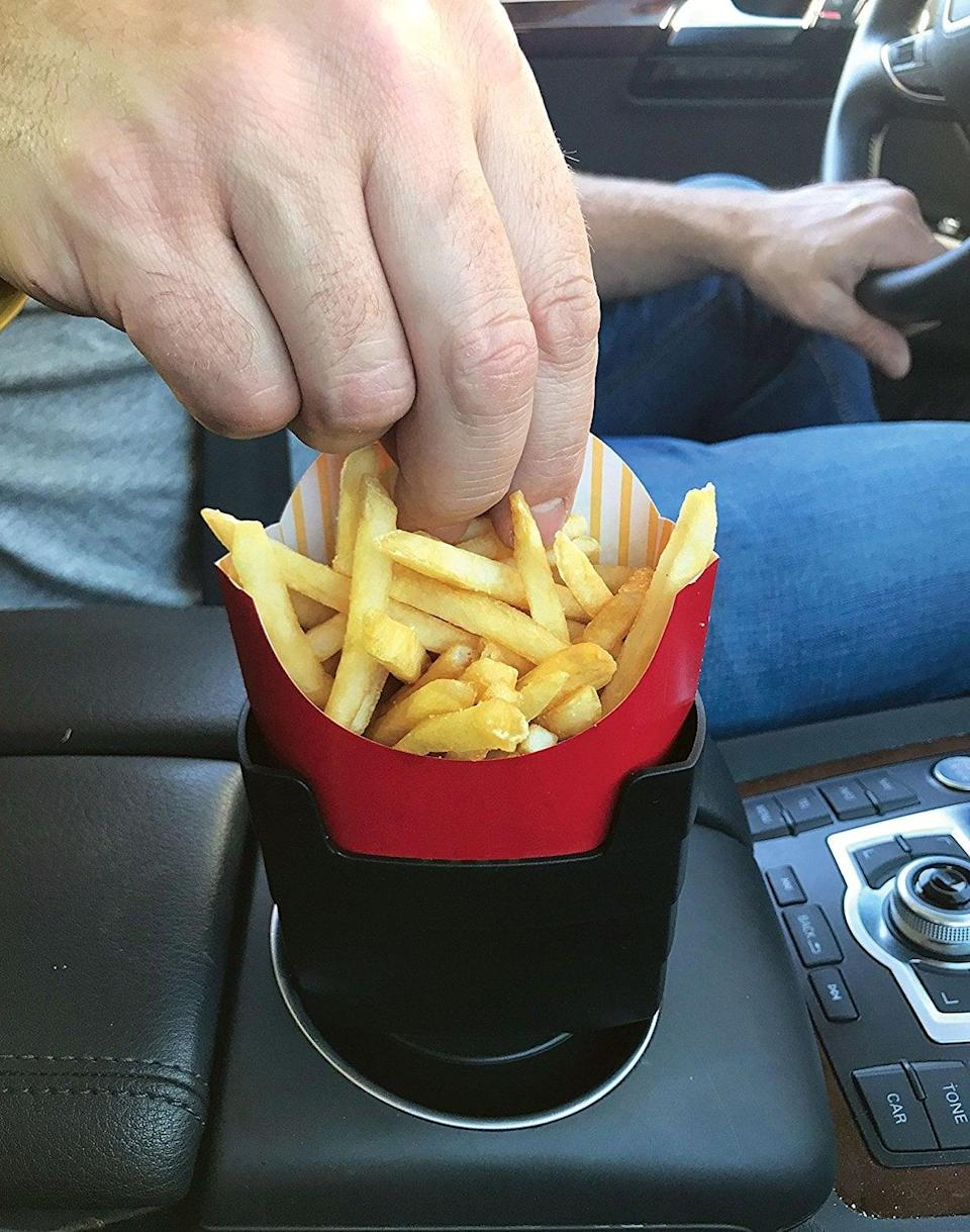 """<p>This <span>""""Fries on the Fly"""" Multi-Purpose Universal Car French Fry Holder</span> ($9) might be the best invention ever. It's perfect for the one who loves to snack on the road. Get them the <span>Saucemoto Dip Clip (2 Pack, Gray)</span> ($10) to complete the gift. It's an in-car sauce holder for ketchup and dipping sauces that clips onto your air vents.</p>"""
