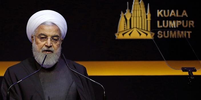 Iranian President Hassan Rouhani delivers a speech at the Kuala Lumpur Summit in Kuala Lumpur, Malaysia, Thursday, Dec. 19, 2019. Leaders from Turkey, Iran, Qatar, Indonesia and Malaysia address delegates during opening ceremony of the Kuala Lumpur Summit 2019, which aims to identify problems that affect the Muslim world.(AP Photo/Lai Seng Sin)