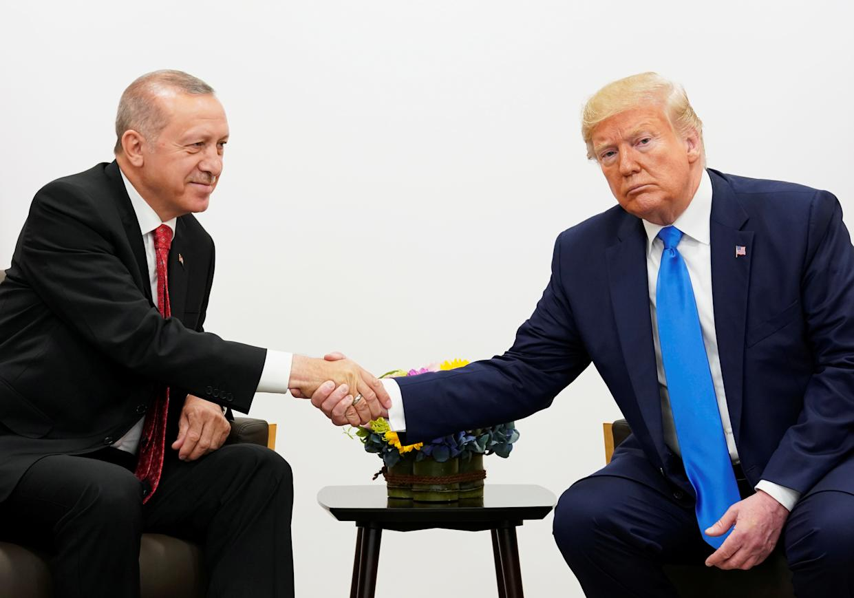 Turkish President Recep Tayyip Erdogan shakes hands with President Trump during a meeting at the G-20 summit in Osaka, Japan, in June. (Photo: Kevin Lamarque/Reuters)