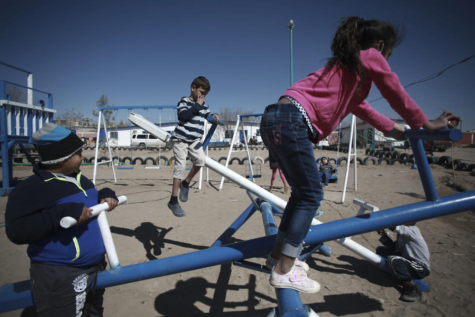 Honduran children migrant play at the Pan de Vida shelter in Ciudad Juarez, Mexico, Friday, Feb. 19, 2021. After waiting months and sometimes years in Mexico, people seeking asylum in the United States are being allowed into the country starting Friday as they wait for courts to decide on their cases, unwinding one of the Trump administration's signature immigration policies that President Joe Biden vowed to end. (AP Photo/Christian Chavez)