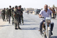 Syrian troops deploy in the village of Ghebesh, west of the town of Tal Tamr, in northern Syria, Monday, Oct 14, 2019. Syrian government troops moved into towns and villages in northern Syria on Monday, setting up a potential clash with Turkish-led forces advancing in the area as long-standing alliances in the region begin to crumble following the pullback of U.S. forces. (AP Photo)
