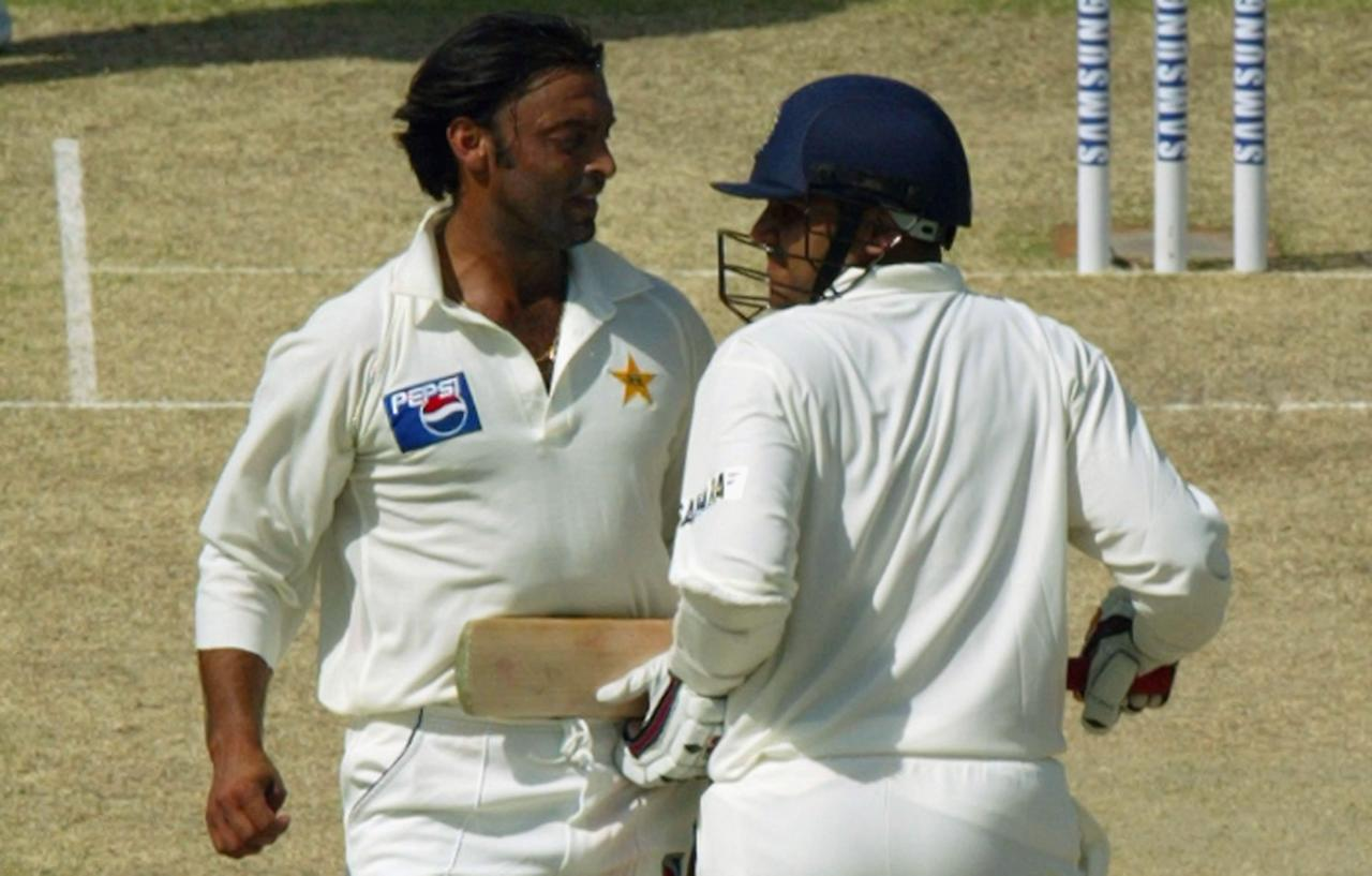 MULTAN, PAKISTAN - MARCH 28:  Virender Sehwag (R) of India and Shoaib Akhtar of Pakistan run into each other as Sehwag completes a run during day 1 of the 1st Test Match between Pakistan and India at Multan Stadium on March 28, 2004 in Multan, Pakistan. (Photo by Scott Barbour/Getty Images)