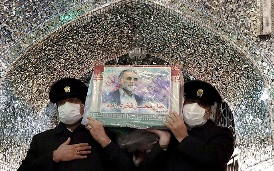 The coffin of Iranian nuclear scientist Mohsen Fakhrizadeh is carried through a shrine in Mashhad, Iran - WANA NEWS AGENCY /VIA REUTERS