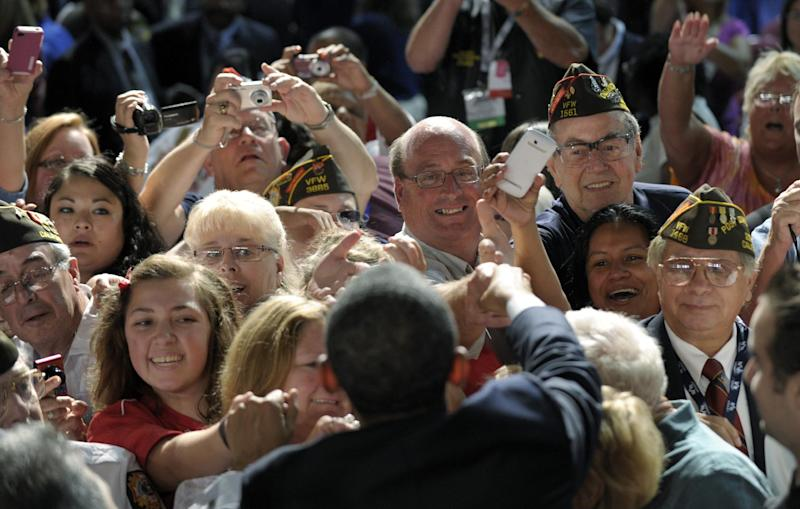 President Barack Obama greets the crowd after speaking at the 113th National Convention of the Veterans of Foreign Wars in Reno, Nev., Monday, July 23, 2012. (AP Photo/Susan Walsh)