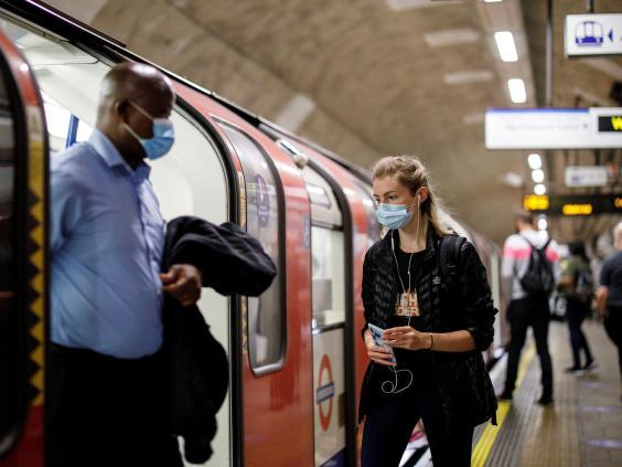 Commuters in London wear face masks following the introduction of new rules on Monday (AFP via Getty)