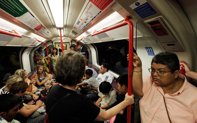Commuters travel on the Central Line - AP