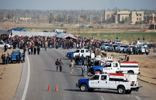 Iraqi protesters block a highway in western Iraq leading to Syria and Jordan, in Ramadi on December 23, 2012