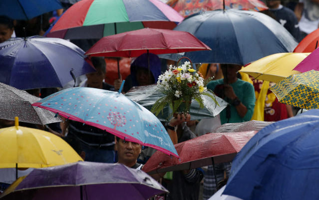 <p>Filipinos troop to Manila's North Cemetery to visit the graves of their loved ones in the traditional observance of All Saints' Day, the honoring of the dead among Catholics all over the world Wednesday, Nov. 1, 2017 in Manila, Philippines. Filipinos go to cemeteries and memorial parks on Nov. 1 to honor and pray for the dearly departed. (Photo: Bullit Marquez/AP) </p>