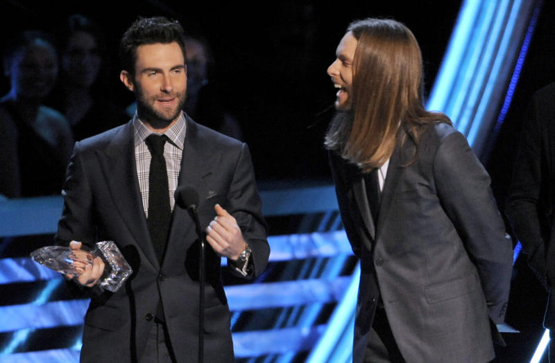 Adam Levine, left, and James Valentine, of Maroon 5, accept the award for favorite band at the Peopleís Choice Awards at the Nokia Theatre on Wednesday Jan. 9, 2013, in Los Angeles. (Photo by Chris Pizzello/Invision/AP)