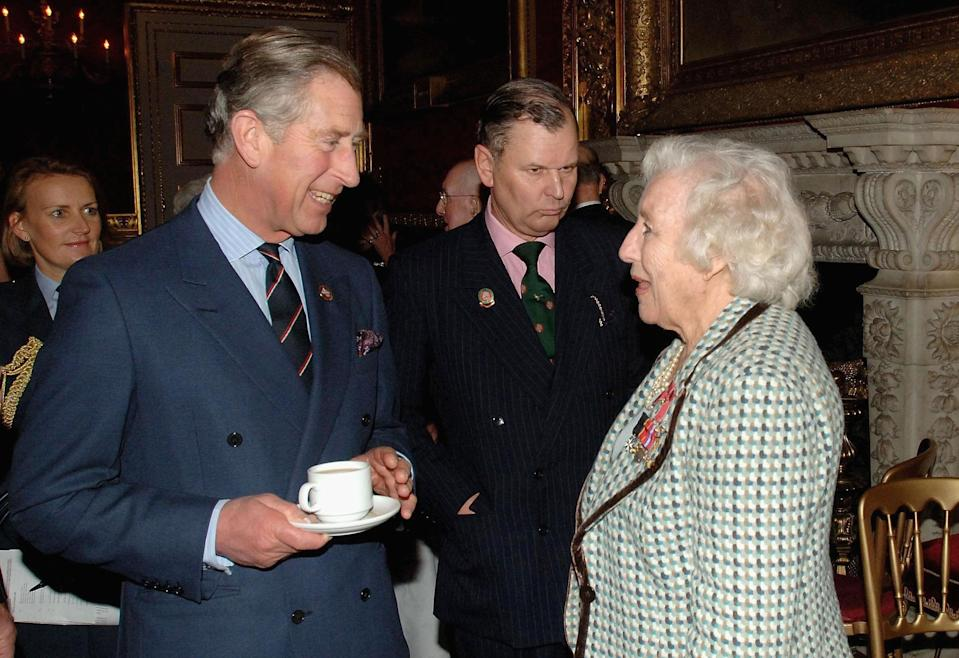 LONDON - DECEMBER 7: (NO PUBLICATION IN UK MEDIA FOR 28 DAYS)  Prince Charles, Prince of Wales chats with Dame Vera Lynn as he visits the 'Not Forgotten Association' at St. James's Palace  on December 7, 2006  in London, England.  The Association works for the benefit of wounded and disabled service and ex-service personnel. (Photo by Pool/Anwar Hussein Collection/Getty Images)