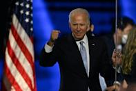 US President-elect Joe Biden pumps his first after delivering his victory speech in Wilmington, Delaware