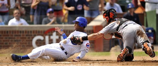 Chicago Cubs' Starlin Castro left, slides safely into home plate on a Welington Castillo double as San Francisco catcher Buster Posey tries to apply the tag in the third inning of a baseball game in Chicago, Friday, Aug. 31, 2012. (AP Photo/Paul Beaty)