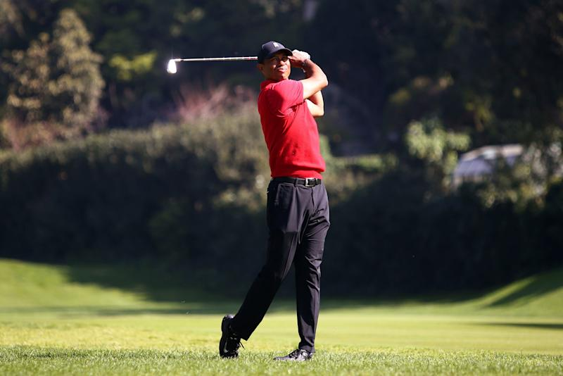 Woods plays a shot on the 12th hole during the final round at Riviera.