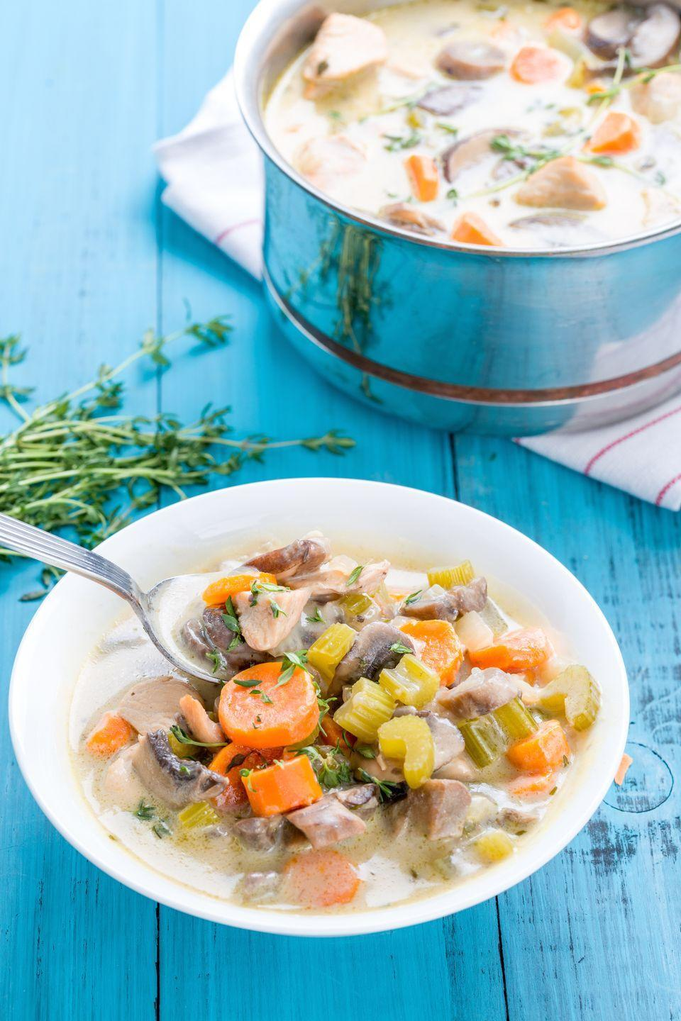 """<p>This updated classic—loaded with celery, carrot, and fresh thyme—is the answer to all your problems on a cold night.</p><p>Get the recipe from <a href=""""https://www.delish.com/cooking/recipe-ideas/recipes/a44387/creamy-chicken-and-mushroom-soup-recipe/"""" rel=""""nofollow noopener"""" target=""""_blank"""" data-ylk=""""slk:Delish"""" class=""""link rapid-noclick-resp"""">Delish</a>.</p>"""