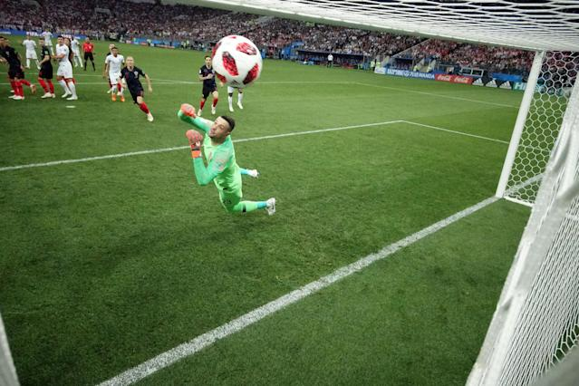 <p>Kieran Trippier of England scores his team's first goal past Danijel Subasic of Croatia during the 2018 FIFA World Cup Russia Semi Final match between England and Croatia at Luzhniki Stadium on July 11, 2018 in Moscow, Russia. (Photo by Michael Heiman – FIFA/FIFA via Getty Images) </p>