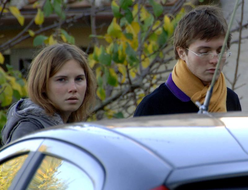 FILE - In this Friday, Nov. 2, 2007 file photo, Amanda Knox, left, and Raffaele Sollecito, are seen outside the rented house where 21-year-old British student Meredith Kercher was found dead in Perugia, Italy. Defense lawyers for U.S. student Amanda Knox and her Italian former boyfriend will get their final say on Monday, Jan. 20, 2014 in the defendants' third trial for the gruesome 2007 murder of Knox's British roommate. (AP Photo/Stefano Medici, File)