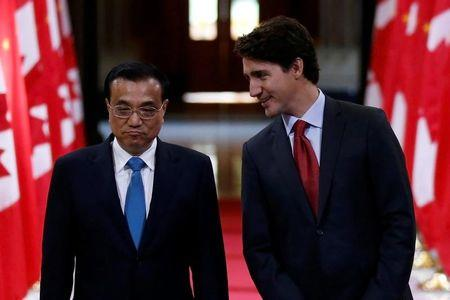 Canada's Prime Minister Justin Trudeau and Chinese Premier Li Keqiang attend a signing ceremony in the Hall of Honour on Parliament Hill in Ottawa