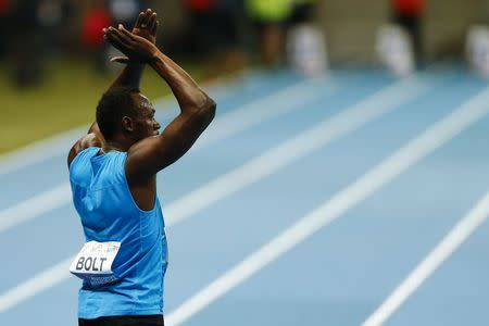 Usain Bolt of Jamaica reacts after winning the men's 100m race during the fifth Athletic Memorial in Warsaw