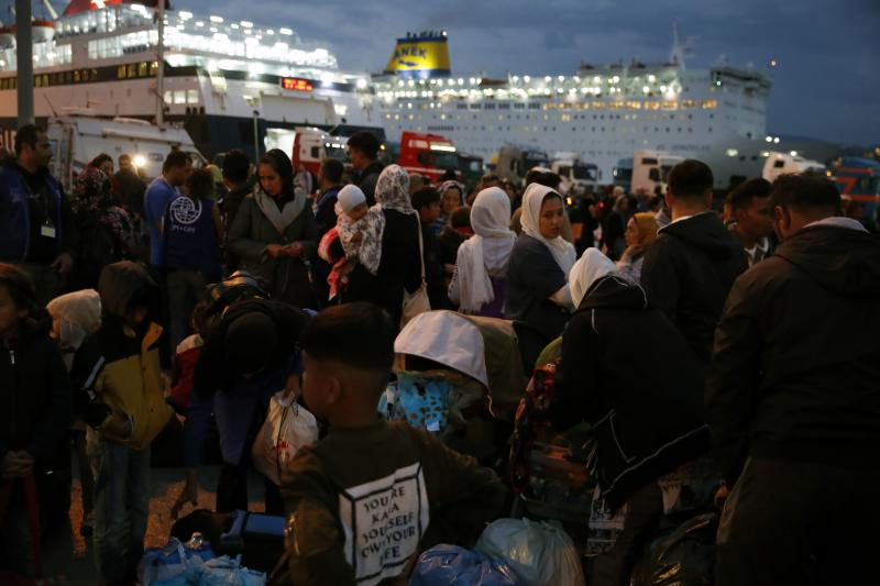 Migrants and refugees arrive from Lesbos island to the port of Piraeus, near Athens, Monday Oct. 7, 2019. In the last 24 hours 668 refugees and migrants have been transferred to mainland Greece from five Greek islands as authorities have accelerated efforts to ease over crowding in the camps. (AP Photo/Thanassis Stavrakis)