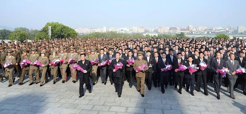 This picture released by North Korea's official Korean Central News Agency (KCNA) on May 19, 2017 shows developers of the strategic ballistic rocket Hwasong-12 visiting the statues of former leaders in Pyongyang