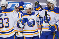 Buffalo Sabres' Drake Caggiula (91) celebrates his second goal of an NHL hockey game during the second period against the Pittsburgh Penguins in Pittsburgh, Thursday, May 6, 2021. (AP Photo/Gene J. Puskar)