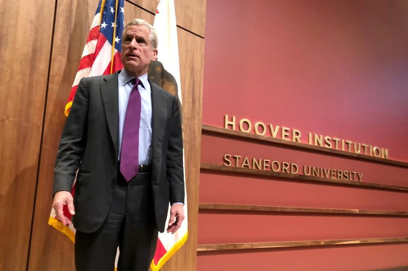 Dallas Federal Reserve Bank President Kaplan stands on a stage in Stanford
