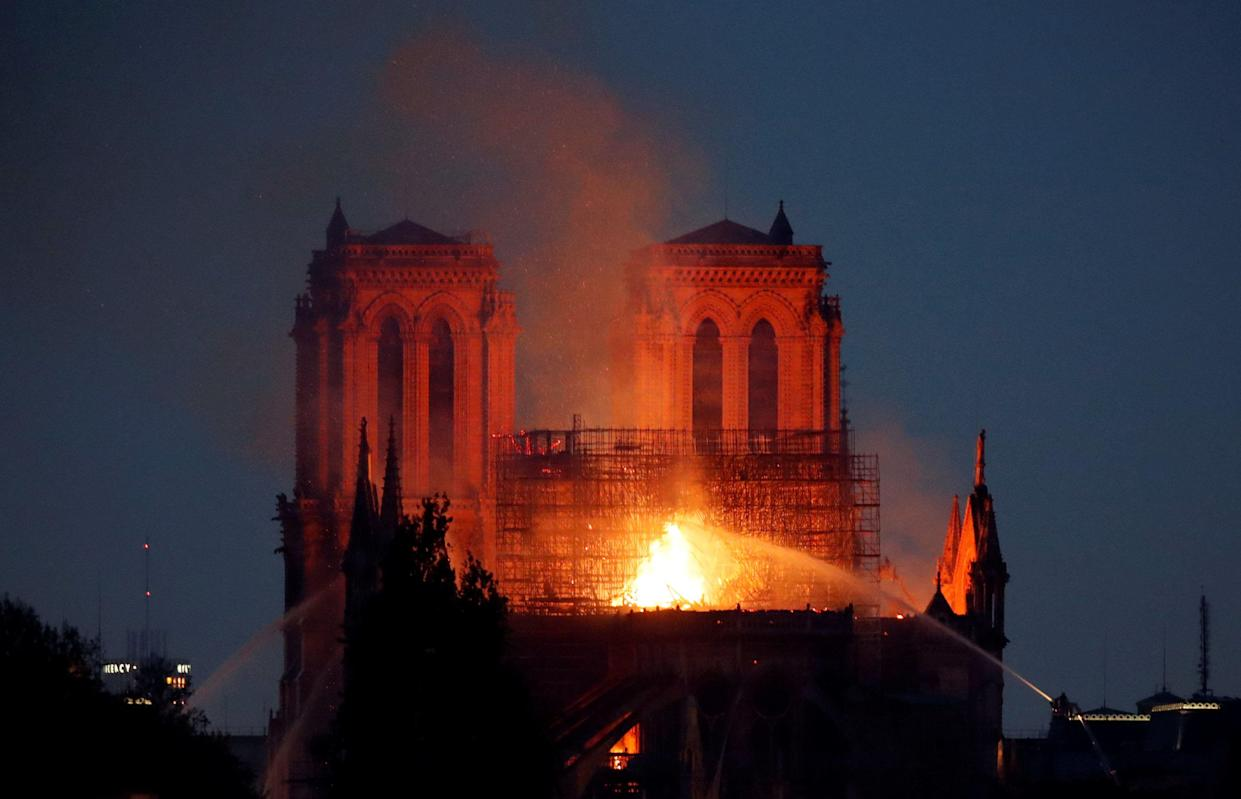 Fire fighters douse flames of the burning Notre Dame Cathedral in Paris, France April 15, 2019. (Photo: Charles Platiau/Reuters)